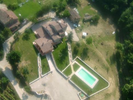 Aerial view of the farmhouse with swimming pool